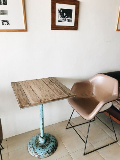 Cafe Indoors  No People Wall - Building Feature Table Furniture Seat Chair Architecture Sofa Still Life Day Flooring Home Interior Built Structure Absence Pillow Decoration High Angle View Tile Tiled Floor