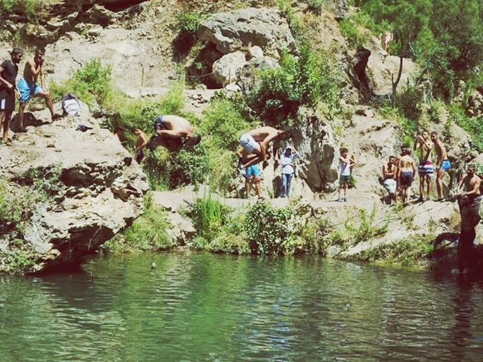 Real People River Water Outdoors Rock - Object Day Men Nature Tree Waterfront Riverbank Occupation Large Group Of People Women Beauty In Nature Mammal Adult People Second Acts