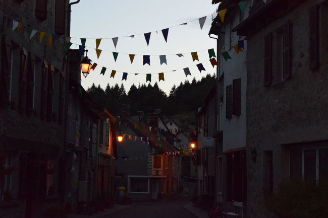 Architecture Building Building Exterior Built Structure Bunting Celebration City Decoration Flag Hanging Illuminated Lighting Equipment Low Angle View Nature Night No People Outdoors Residential District Silent Time Sky Street