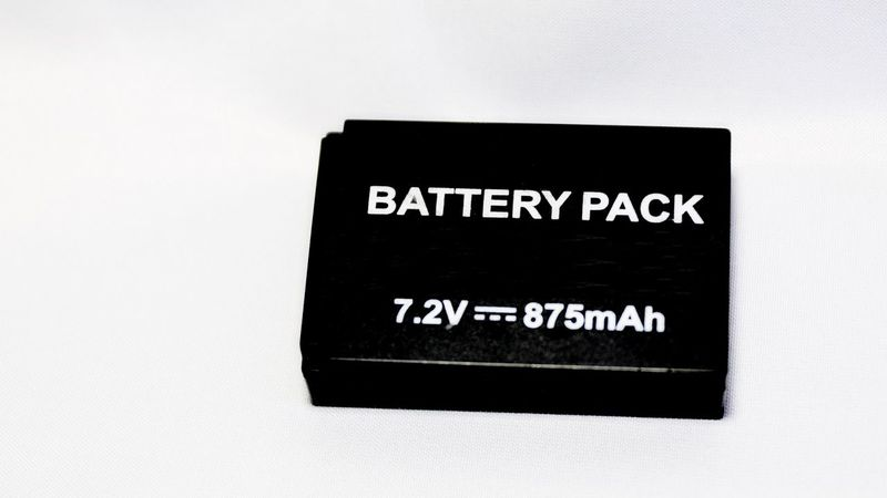Battery pack exclusive for small single lens reflex camera 43 Golden Moments Fuel Lithium Made In Japan SLR SLR Camera Battery Close-up Energy Equipment Fuel And Power Generation Pack Parts Plastic Recharge Stockphoto Stockphotography Studio Shot Supply Technology Volt Western Script White Background