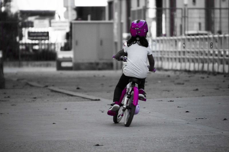 Pink on wheels Transportation One Person Full Length Child Childhood Ride Sport Riding Helmet Bicycle Architecture Mode Of Transportation Land Vehicle Lifestyles Rear View Built Structure Headwear Casual Clothing Leisure Activity Focus On Foreground Outdoors Pink Color Girl Girl Power Cycling Moments Of Happiness The Art Of Street Photography The Street Photographer - 2019 EyeEm Awards