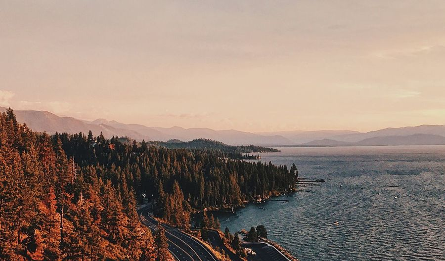 ☀️🌲 Canon_photos Canon Photooftheday Lake View Lake Dusk Colours Dusk In The City Dusk Tahoe Colors Scenics - Nature Sky Beauty In Nature Water Sunset Tranquility Tree Mountain Mountain Range Nature Plant Cloud - Sky