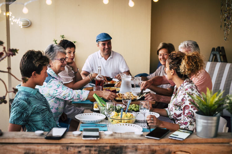 Cheerful family having dinner at home