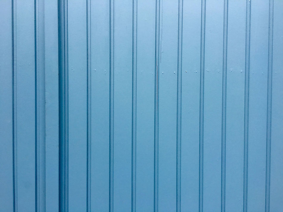 Old wooden door Architecture Backgrounds Basement Door Blue Close-up Corrugated Iron Day Detail Door Full Frame Garage Door No People Old Outdoors Paint Parallel Pattern Planks Of Wood Protection Refurbish Refurbished Striped Textured  Vertical Wood - Material