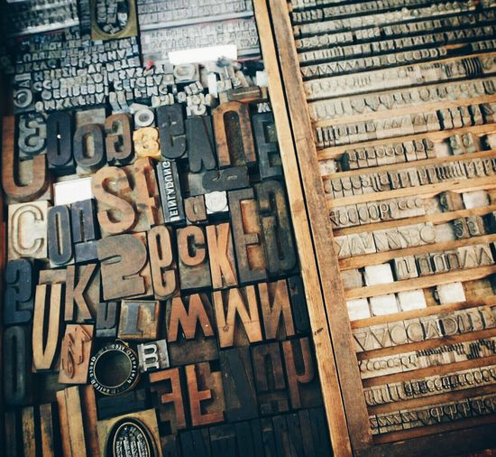 Full Frame Shot Of Old Wooden Printing Letters