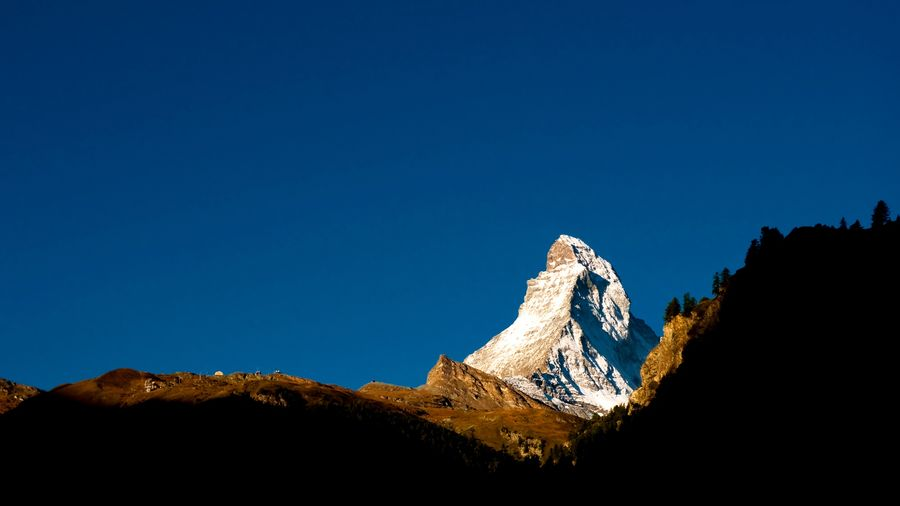 The unique and beautiful Matterhorn, Switzerland Matterhorn  Mountain Range Copy Space Blue Sky Clear Sky Nature No People Low Angle View Beauty In Nature Outdoors Sunlight Rock Rock Formation Solid Travel