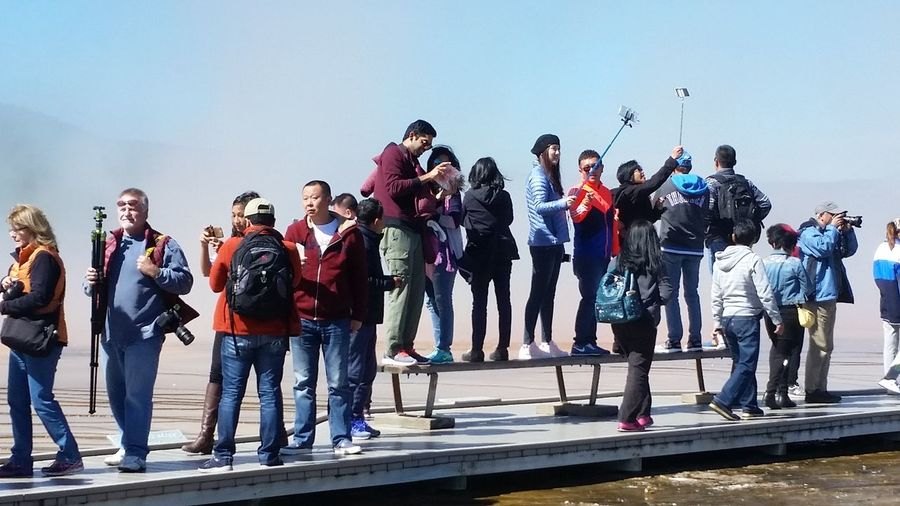 Selfies Asians With Cameras Large Group Of People Tourism Say Cheese! Yellowstone National Park Asian Tourists Asians In America Cameras Selfie Stick Fun Grand Prismatic