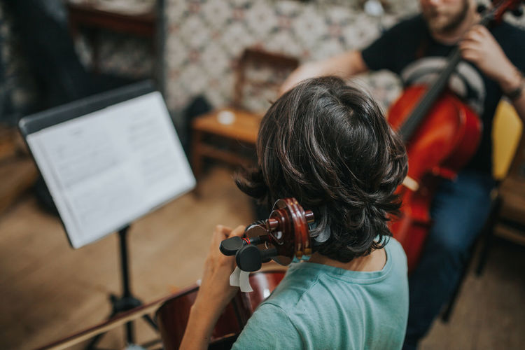 Learning Music Music Academy Teaching Activity Cello Focus On Foreground Lifestyles music brings us together Music Class Music Is My Life Music School Musical Musical Equipment Musical Instrument Musical Instrument String Musical Instruments Musicians Rear View Skill  Teacher Analogue Sound