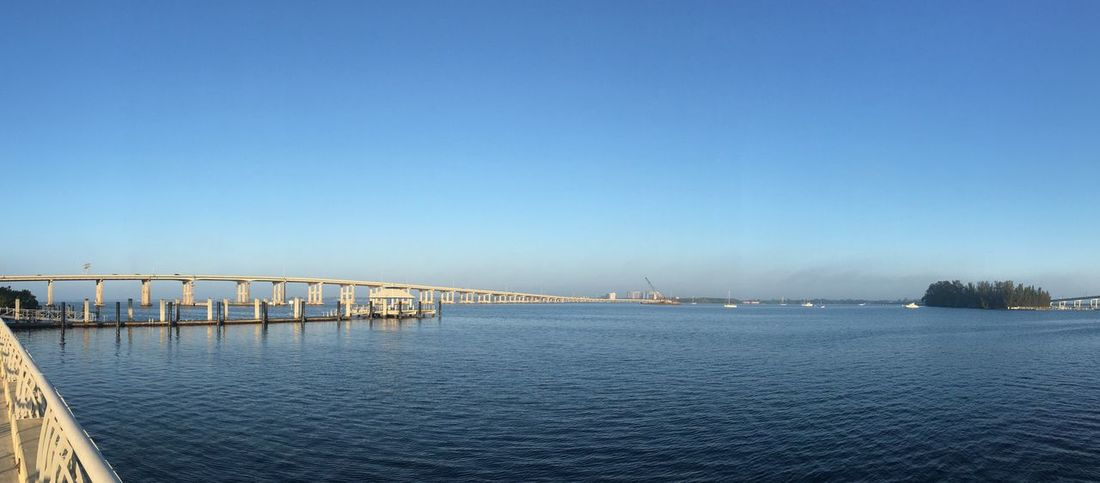 Panorama shot of the river in the morning Clear Sky Copy Space Built Structure Water Bridge - Man Made Structure Connection Outdoors No People Day Sky Architecture City Hazy  Bridge Scenics River Blue Clear Sky Backgrounds Panorama