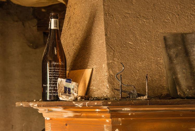 Old wine bottle by wall