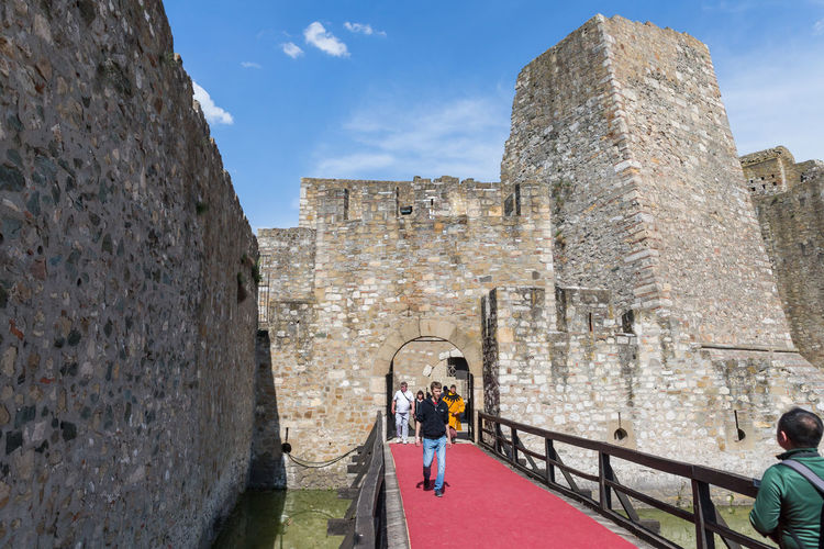 Smederevo, Serbia, May 03, 2019 : Bridge over a moat filled with water in the ruins of the Smederevo fortress, standing on the banks of the Danube River in Smederevo town in Serbia. Knight - Person Protection Landmark Strength Culture And Tradition Construction National Ancient Architecture Famous Place Military Fortification Wall Travel Destinations Sky Tower Historical Building Medieval Architecture Europe Fortress Wall Heritage Monument Castle Smederevo Serbia Day Architecture Ruins