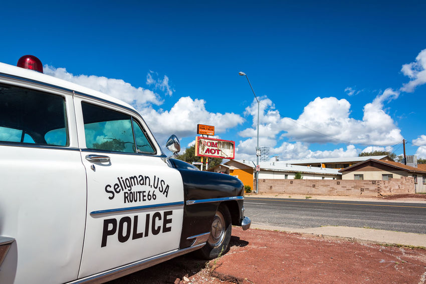 SELIGMAN, AZ - SEPTEMBER 16: Old police car sits on Route 66 in Seligman, AZ on September 16, 2015 Arizona Car Chrysler Classic Classic Car Day Highway Historic Land Vehicle Mode Of Transport New Yorker New Yorker Deluxe No People Outdoors Police Police Car Route Route 66 Seligman Text Tourism Transportation Transportation Travel Travel Destinations