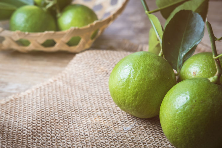 Close-Up Of Green Fruits On Table