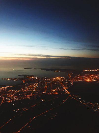 Water Illuminated Sky Sea Scenics - Nature Nature No People City Cloud - Sky Sunset Beauty In Nature Land