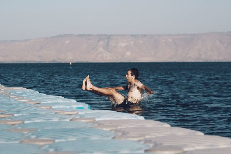 Enjoy The New Normal Kineret Israel Full Length Live For The Story The Great Outdoors - 2017 EyeEm Awards My Year My View Leisure Activity One Person Nature Sea Sky Sitting Young Adult Beauty In Nature Scenics Day Young Women Outdoors Mountain Beauty In Nature מייכינרת Eye4photography  Nature waiting game