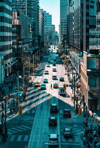 Timing is everything Toronto City Mode Of Transportation Transportation Car Architecture Building Exterior Motor Vehicle Incidental People Office Building Exterior Travel Cityscape Traffic High Angle View Road City Life Land Vehicle Built Structure Street City Street Building