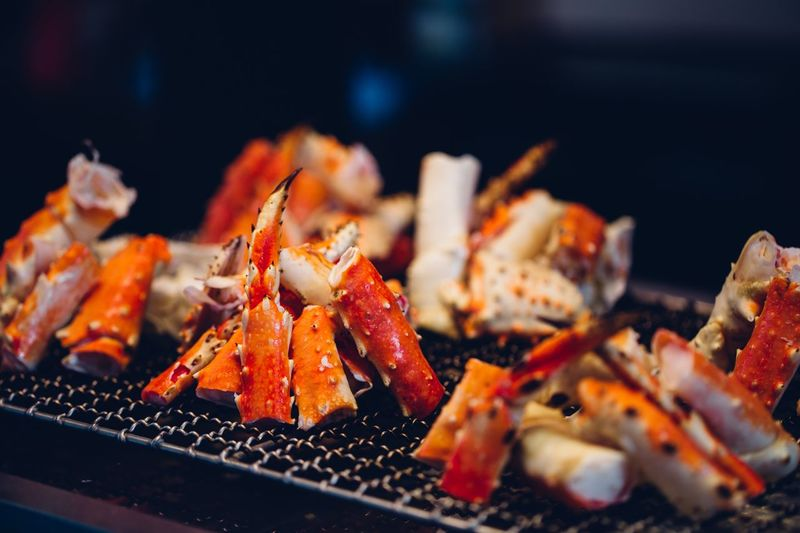 Close-up of crabs on barbecue grill
