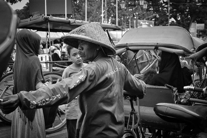 At Malioboro Jogjakarta, precious moment for short time transit. I really love this place Malioboro Jogja Indonesia Human Interest Street Photography Black And White People Activity Pedicab Transportation Traditional Emotions Pedestrianeditorial