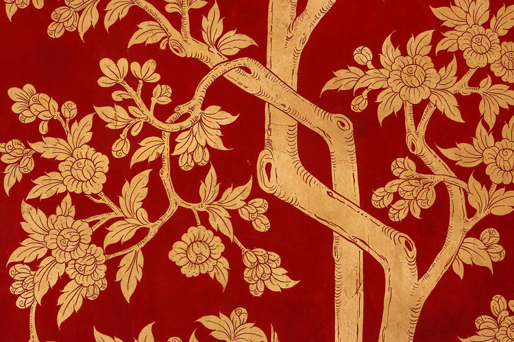 Detail of traditional red painting depicting trees and leaves on a door at the the Wat Phra Kaew Palace, also known as the Emerald Buddha Temple. Bangkok, Thailand. Architecture Bangkok Thai Thailand Wat Phra Kaew Art And Craft Backgrounds Buddhism Close-up Craft Decoration Design Floral Pattern Full Frame Landmark No People Pattern Red Religion Representation Royal Palace Travel Destinations Wall - Building Feature
