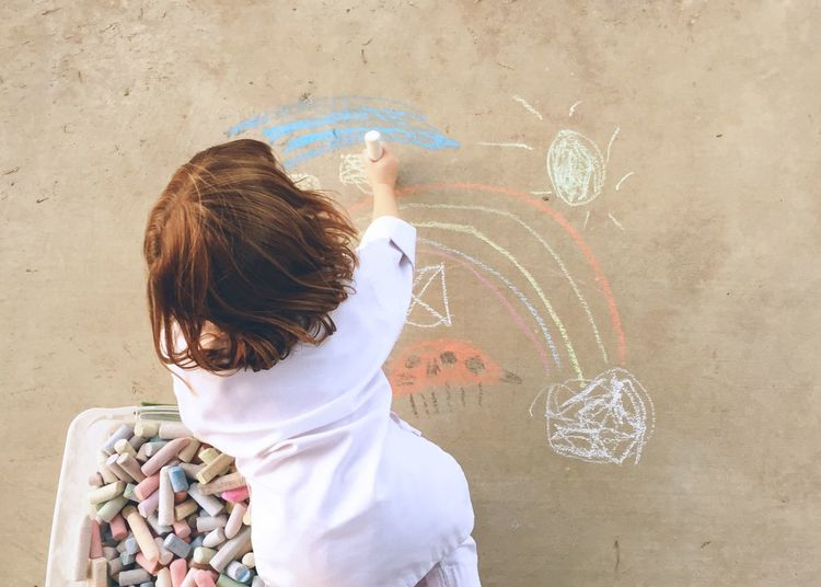 Child drawing on ground with chalk. Creativity Looking Down Girl Chalk Drawing Chalk Art Chalk Rear View One Person Real People Standing Lifestyles Childhood Day