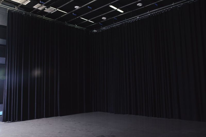 Curtain on empty stage