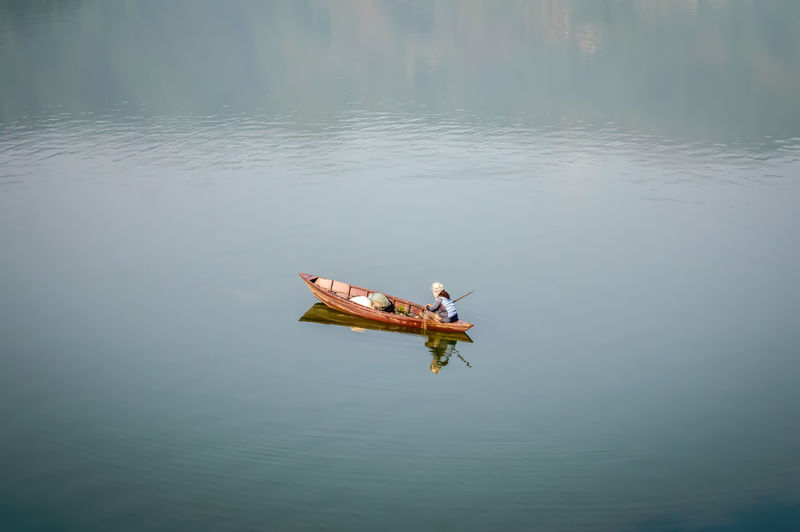 Lonely man in the sea with kayak after and recreation during summer vacation concept. Nepal, Outdoor, People, Relaxation, Ride, Season Activities, Activity, Autumn, Boat, Boatman Beauty In Nature Canoeing, Summer, Flare, Rowing, Beautiful Cold, Fisherman, Fishing, Fun, Hobby Day Holiday, Kayak, Kayaking, Leisure, Nature Lake Mode Of Transportation Nature Outdoors Reflection Summer Vacation, Summertime, Sunny, Sunrise, Sunset Sunlight, Vacations, Outdoors, Vessel, Carefree, View, Surface, Paddling, Floating Tourism, Tourist, Travel, Water, Winter, Adventure Tranquility Transportation Water Waterfront Weekend, Nautical, Recreational, Lifestyles A New Beginning British Culture