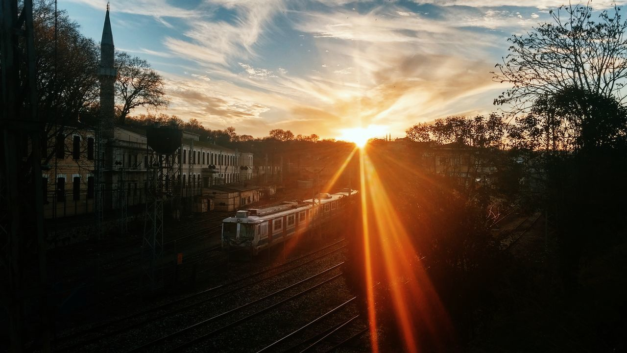 sunset, sun, lens flare, sunlight, sunbeam, transportation, sky, tree, no people, nature, silhouette, beauty in nature, outdoors, scenics, day