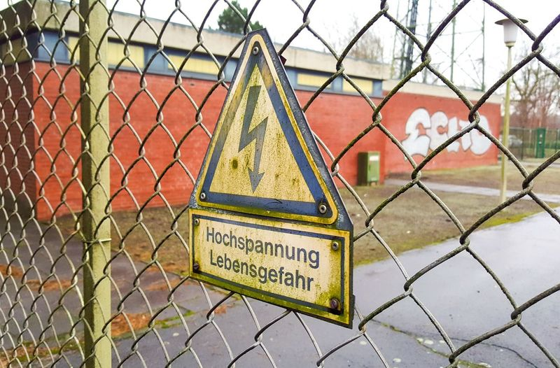 Transformation Power Voltage Road German Urbanphotography Fotography Outdoors Nopeople Grafitti Streetphotography Outside Public City Object Urban Germany Foto Sign ACDC Signs Graffiti Street Day Industrial