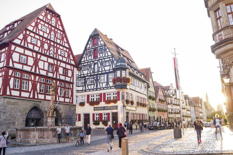 German Old Town Sunlight Architecture Building Exterior Built Structure City Clear Sky Colorful Day Gernany Large Group Of People Medieval Men Outdoors People Real People Rothenburg Ob Der Tauber Sky Timbered House Tourism Travel Destinations Your Ticket To Europe