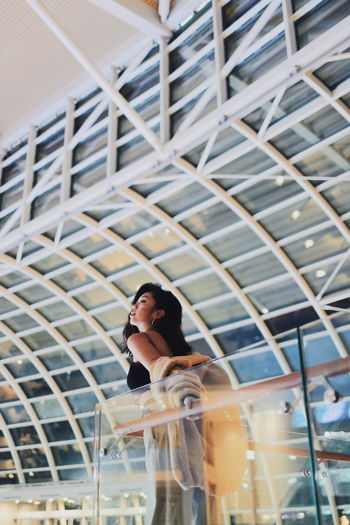 Young woman standing in shopping mall