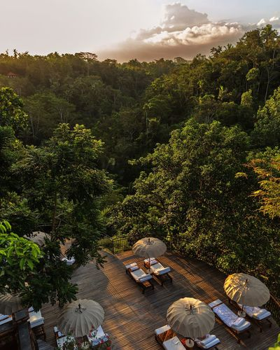 Sunset in Komanek at Tanggayuda, Ubud. A special in the jungle on the rooftop overlooking the volcano Batukaro. Feel The Journey Ubud Bali Jungle