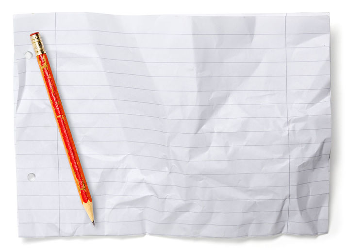 Directly above shot of blank crumpled paper against white background