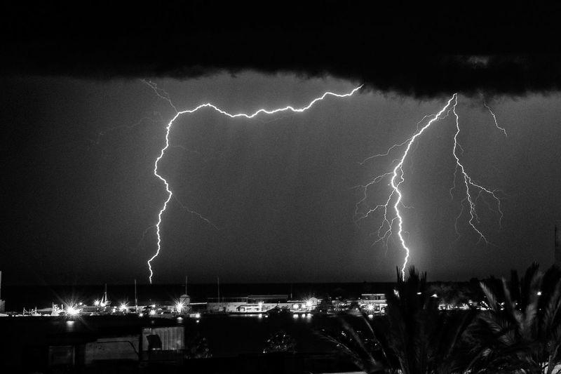 Lightning strike against sky at night