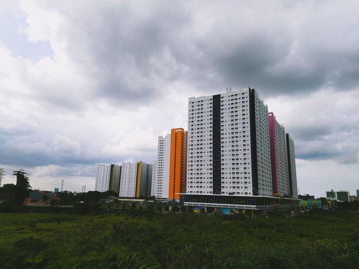 Modern buildings against sky in city