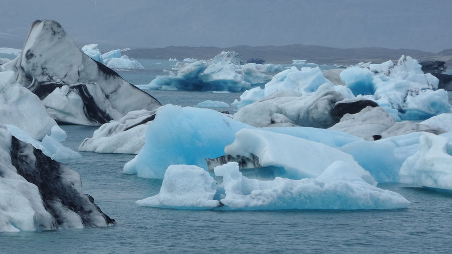 Scenic view of blueish icebergs