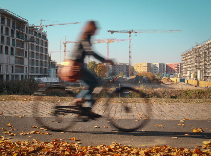 Motion Built Structure City Bicycle Building Exterior Mode Of Transportation Land Vehicle Ride Lifestyles Outdoors Transportation