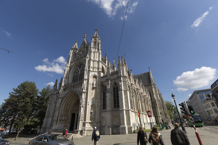 Brussels, Belgium. May 3, 2018: Exterior of the Church Notre Dame Du Sablon with people who walk by it. Architecture Belgique Belgium Brussels Church Construction Du Sablon Exterior Façade Gothic Gothic Architecture Notre Dame Du Sablon Spirituality Architecture Belgian  Building Building Exterior Built Structure Europe Gothic Style Monument Sky Temple Travel Destinations Urban