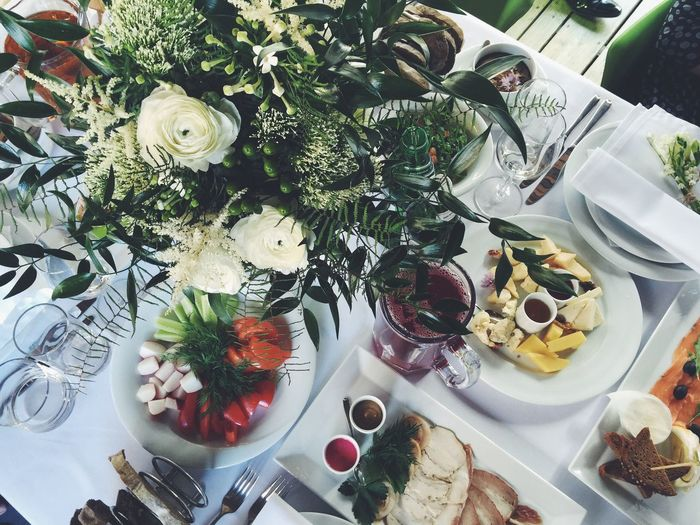 High angle view of vase and food on table during wedding
