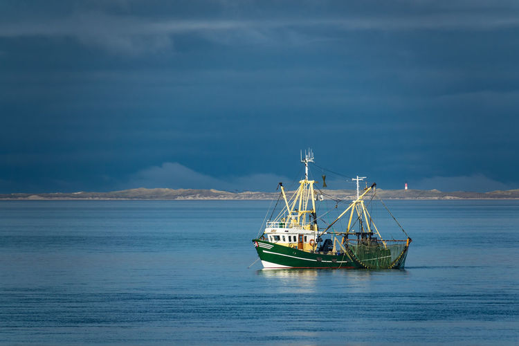 Shrimp boat on the North Sea. Amrum Shrimp Boat Beach Beauty In Nature Cloud - Sky Cutter Day Horizon Over Water Journey Nature Nautical Vessel No People Northsea Ocean Outdoors Scenics Sea Shrimp Fishing Sky Tranquility Transportation Travel Destinations Water Waterfront