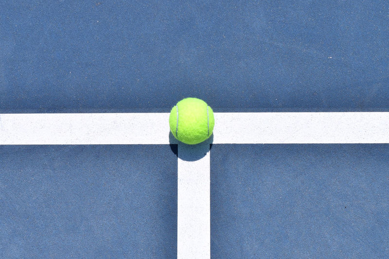 High angle view of yellow ball on white background