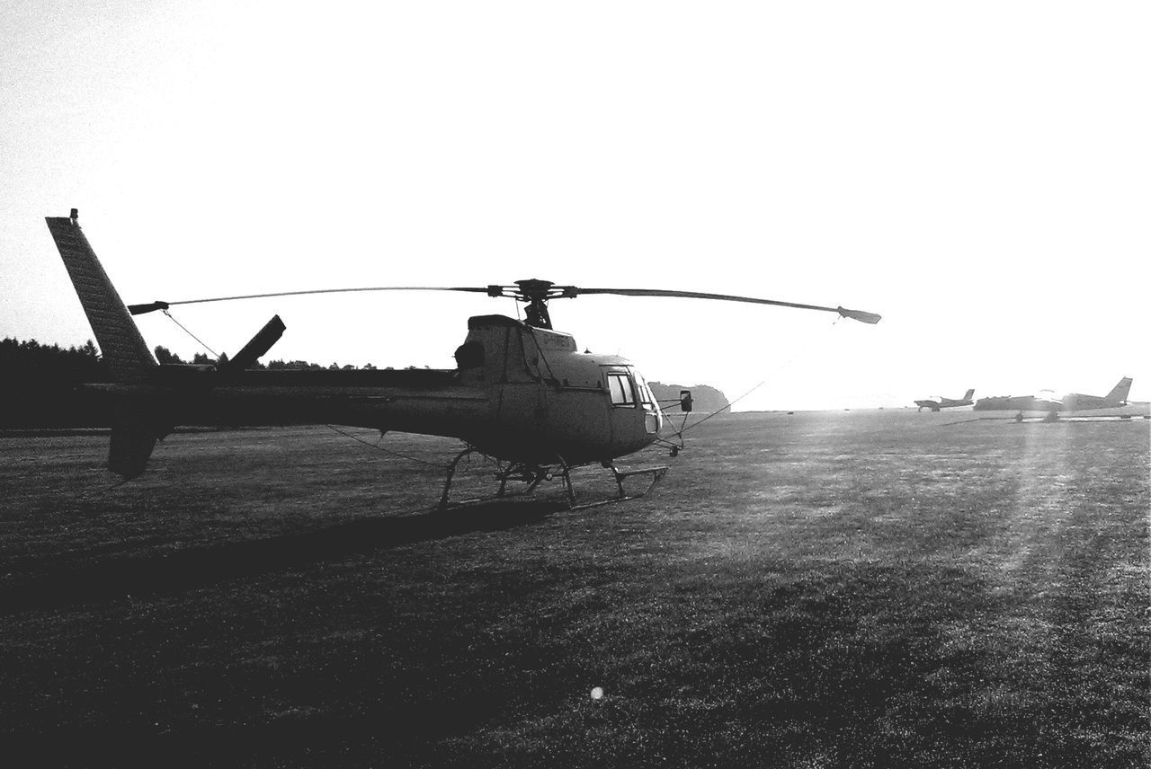 clear sky, helicopter, transportation, field, day, outdoors, no people, nature, sky