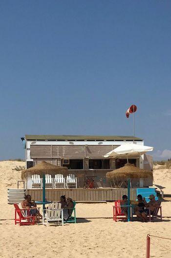 Beach Bar Building Exterior Clear Sky Sunlight Outdoors Day Sea Water