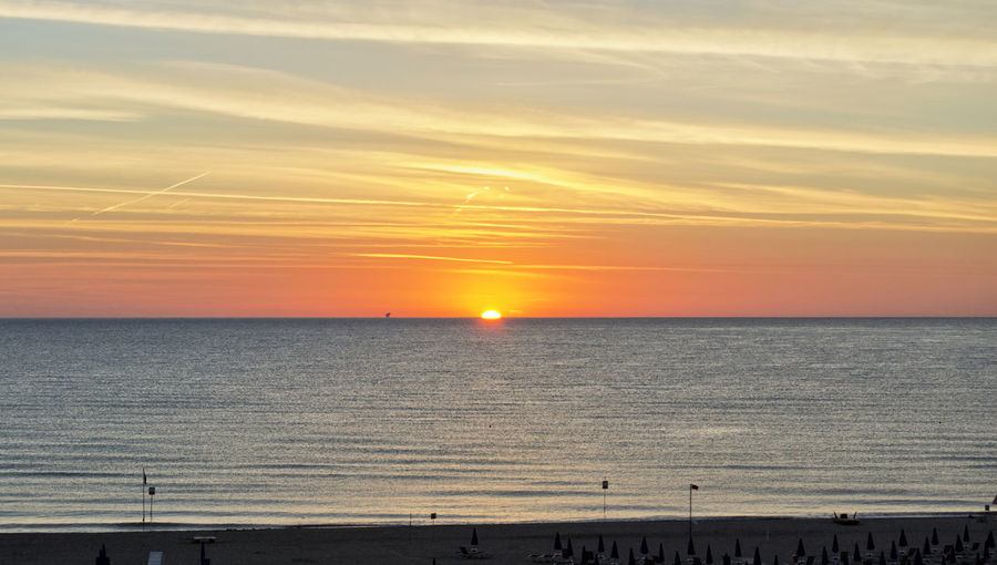 orange dawn over mediterranean sea in summer. for travel and naturalistic concept Beach Beauty In Nature Cloud - Sky Horizon Horizon Over Water Idyllic Land Nature No People Non-urban Scene Orange Color Outdoors Romantic Sky Scenics - Nature Sea Sky Sun Sunset Tranquil Scene Tranquility Water