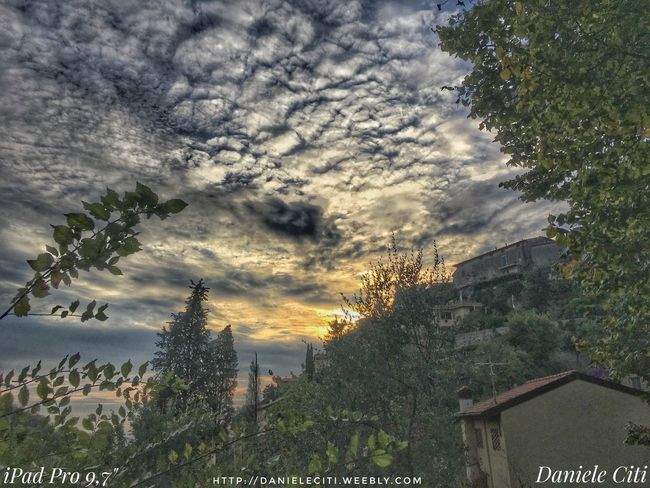 Architecture Atmospheric Mood Beauty In Nature Branch Building Exterior Built Structure Cloud Cloud - Sky Cloudscape Cloudy Growth High Section Ipad Pro Italy Majestic Nature No People Outdoors Scenics Sky Sunset Town Tranquil Scene Tranquility Tree