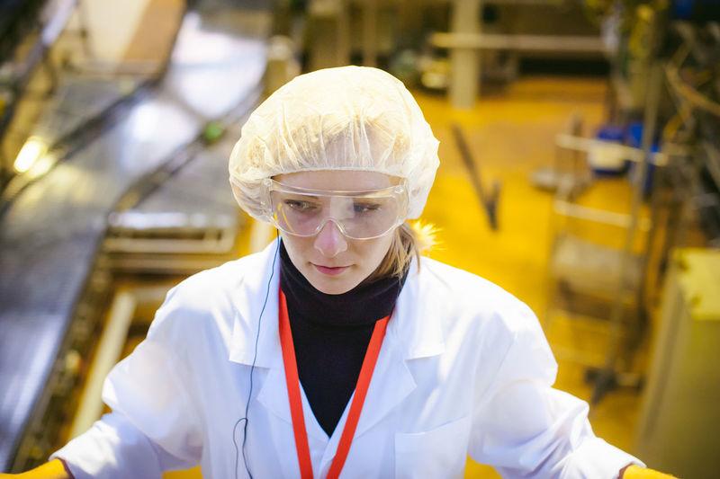 Scientist Working In Factory