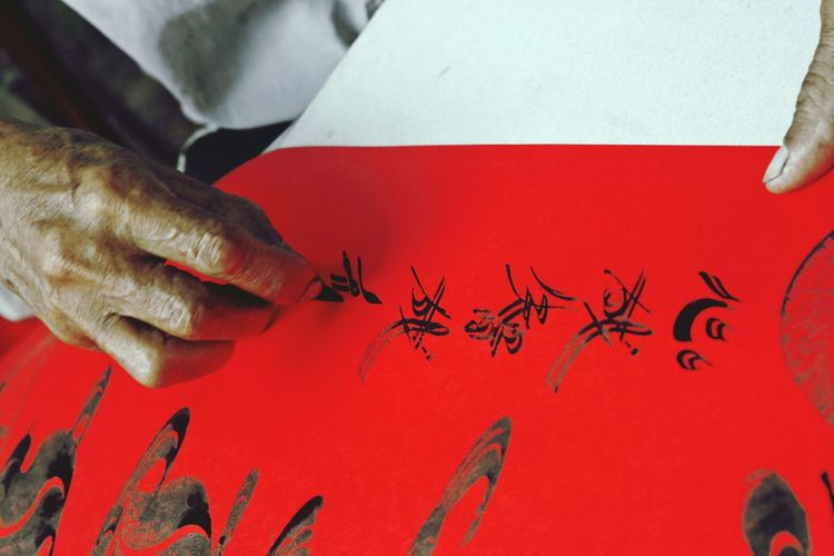 Close-up of calligrapher working in studio