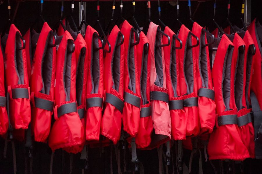 Life Vest Swimsuit Red In A Row Hanging Side By Side No People Large Group Of Objects Arrangement Drying Order Choice Textile Pattern