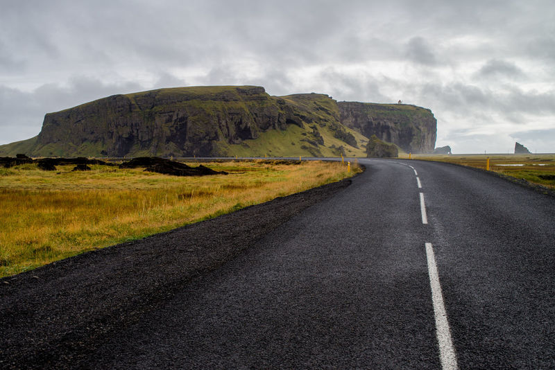 Cloud - Sky Day Dyrhólaey Highway Iceland Landscape Nature No People Outdoors Overcast Road Rural Scene Scenics Storm Cloud The Way Forward Winding Road
