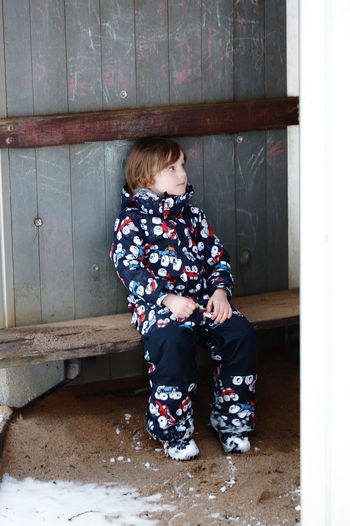 Playground Playing Playground Equipment Boy Child Childhood Fun Snow Winter Wintertime Wintergames Portrait Portrait Of A Child Laughing Outdoors Winter Playtime Playtime Activity Action Slide Slide - Play Equipment Funny Warm Clothing Real People People