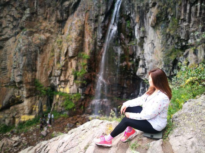 Active weekend Young Women Sitting Full Length Women Waterfall Beautiful Woman Mountain Beauty Water Rock - Object